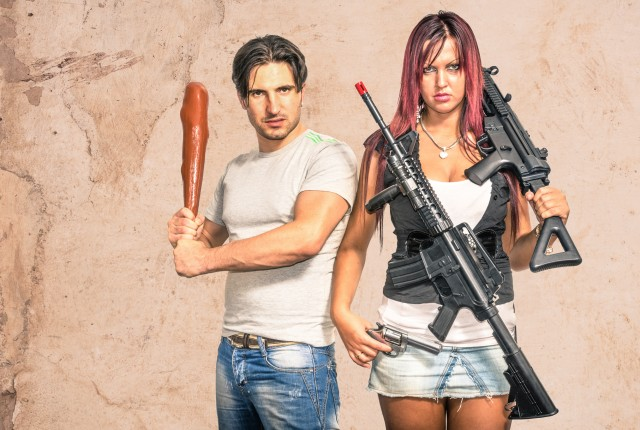Primitive man and modern woman with weapons - Funny Couple